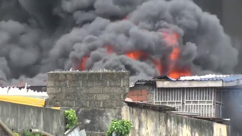 Hero with a BUCKET tries to extinguish huge blaze