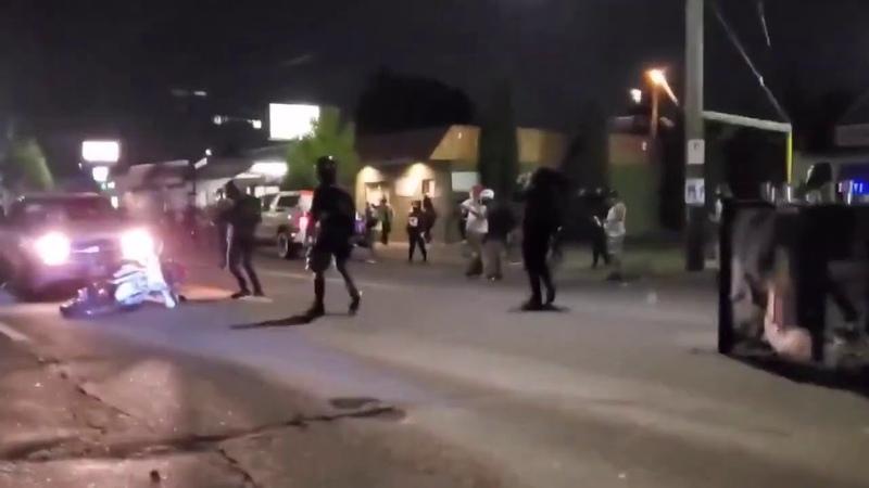 Pickup speeds thru Antifa PDX riot blockade sparks flying from motorbike dragged under the car